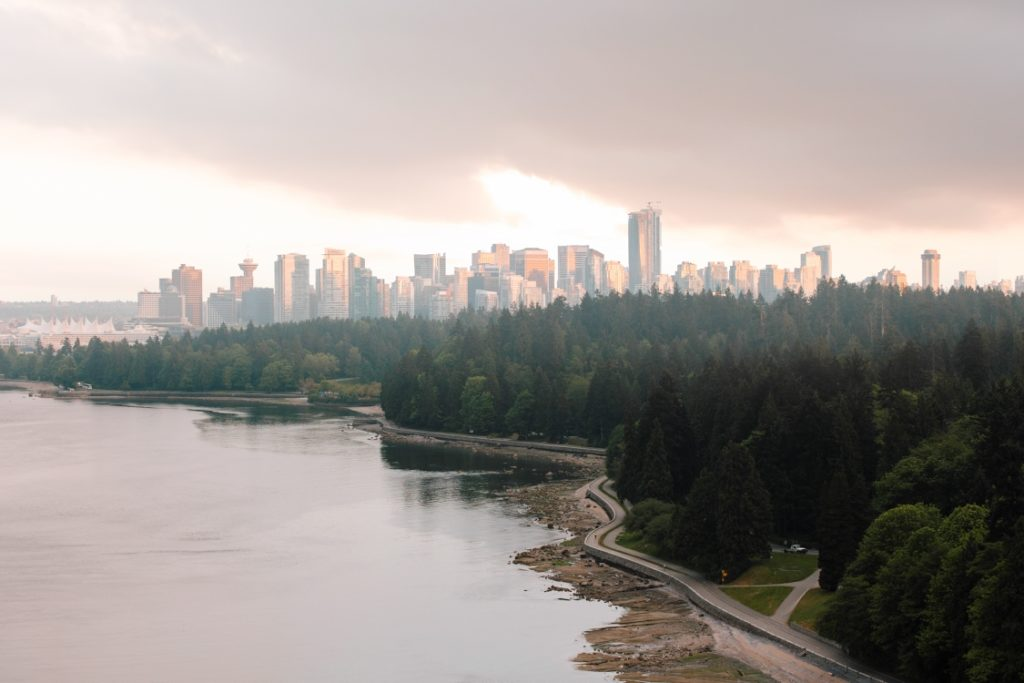 The Stanley Park Seawall winds towards the Vancouver skyline.
