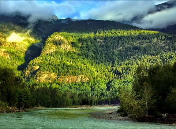 Sun beams sparkle as the catch the lush Bella Coola Valley.