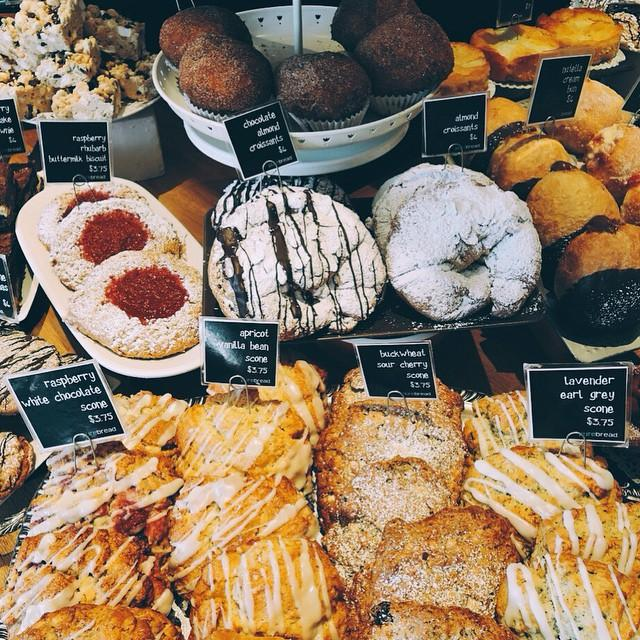 A table full of freshly baked pastries and treats, including croissants, scones, and more.