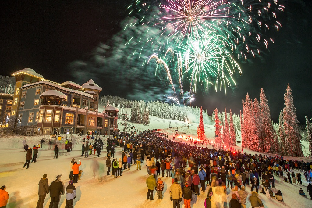 Colourful fireworks explode over a quaint skiing village.