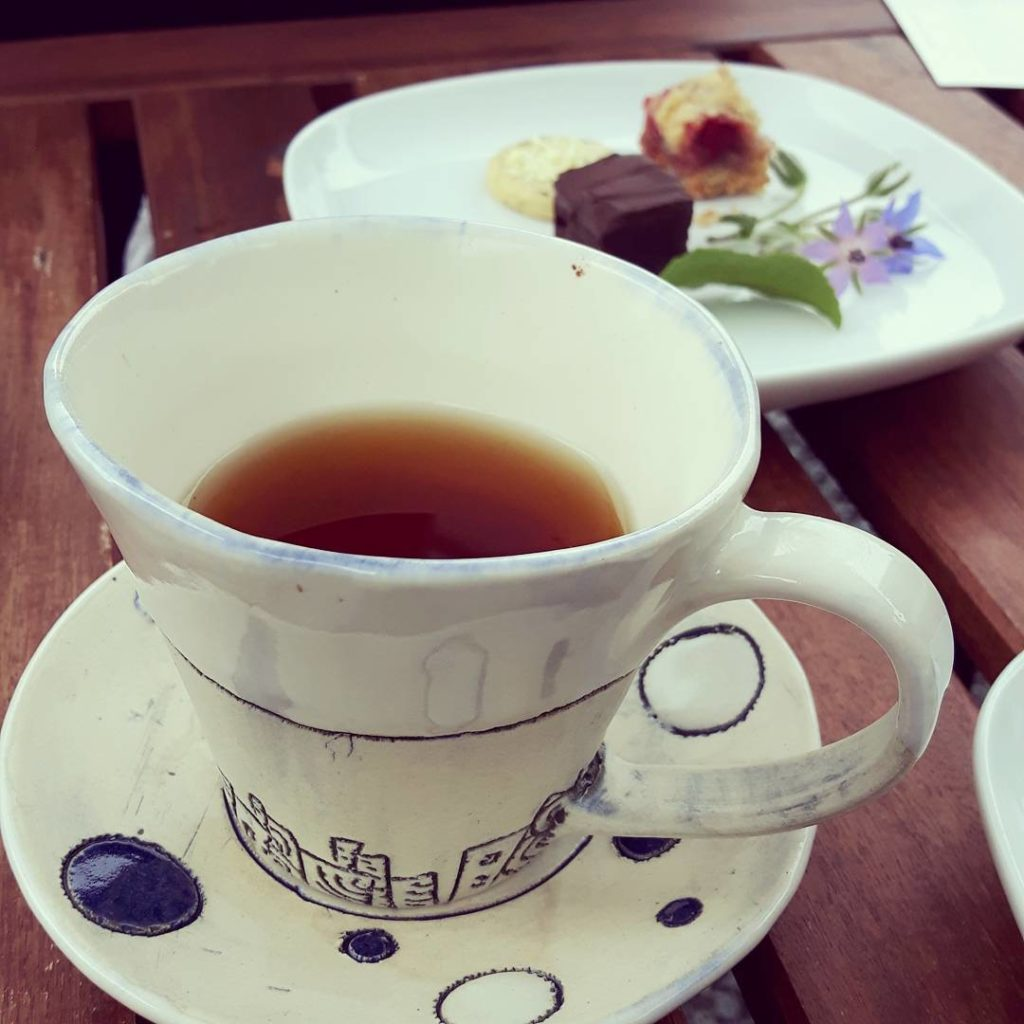A warm cup and tasty treats at Westholme Tea Farm.