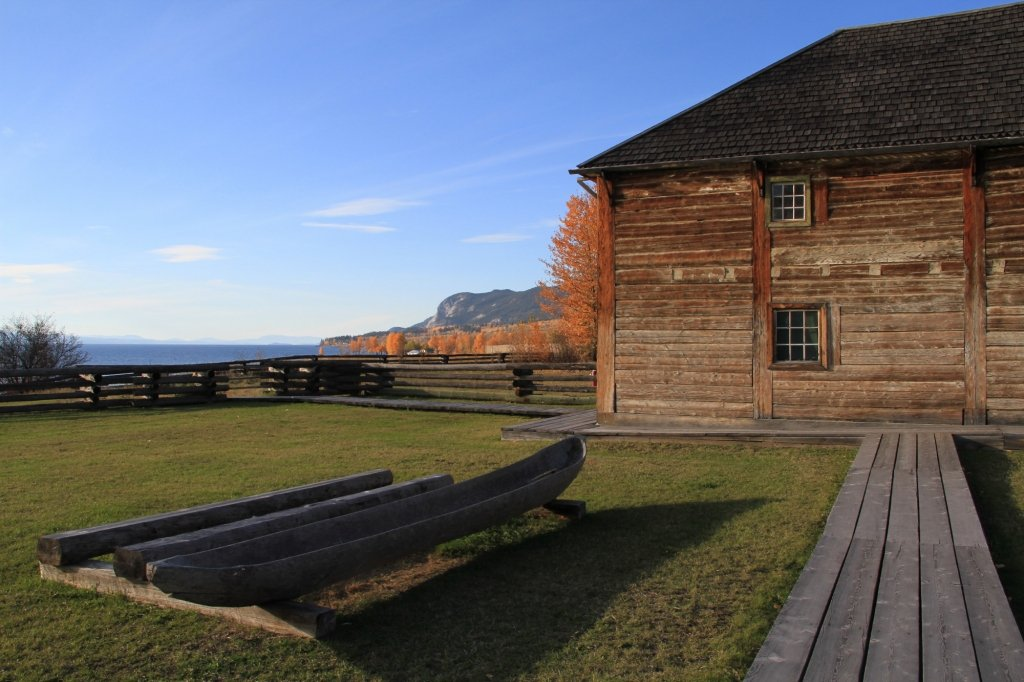 A historic wooden fort overlooking the water.