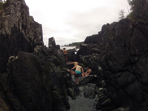 People climbing into the soaking pools at Hot Springs Cove in Tofino, BC.