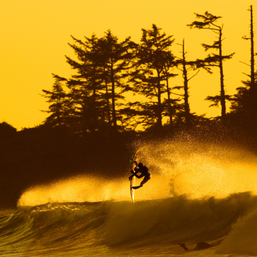 @petedevries surfing a big wave at North Chesterman Beach near Tofino with yellow skies in teh background by @jeremykoreski