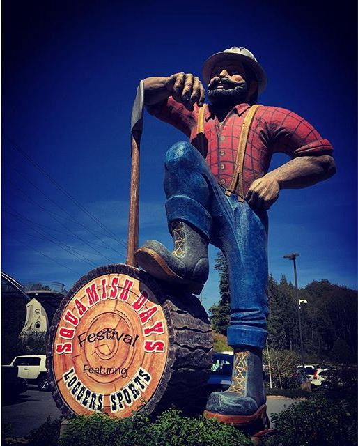 A statue depicting a giant lumberjack.