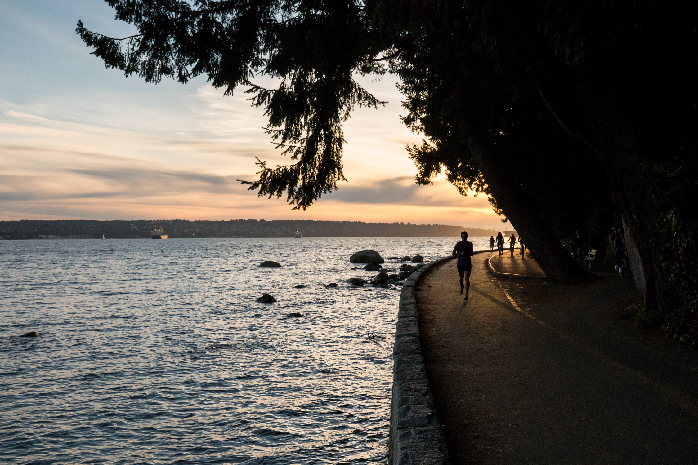 Jogging along the Stanley Park Seawall in Vancouver