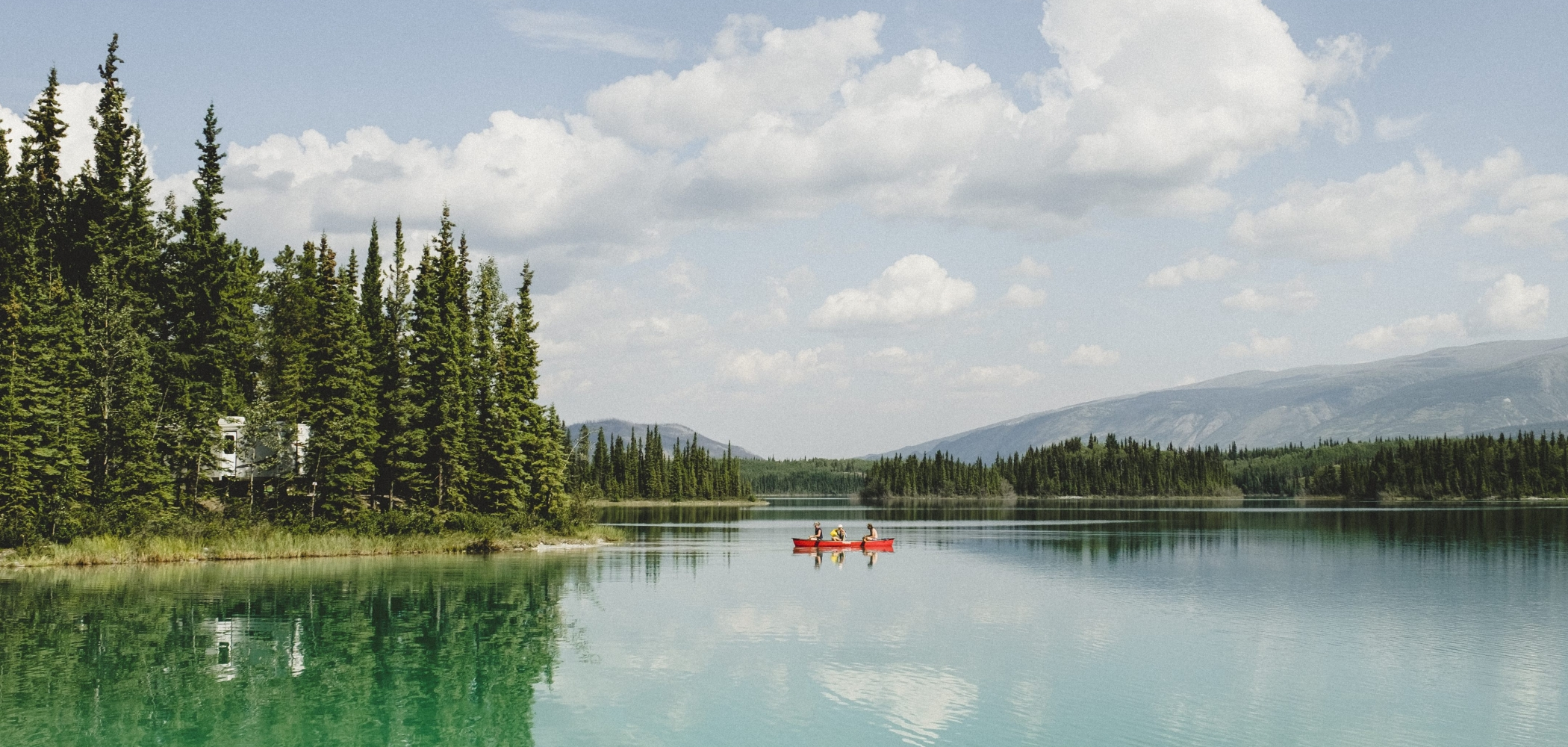 Two people canoeing on a lake in British Columbia