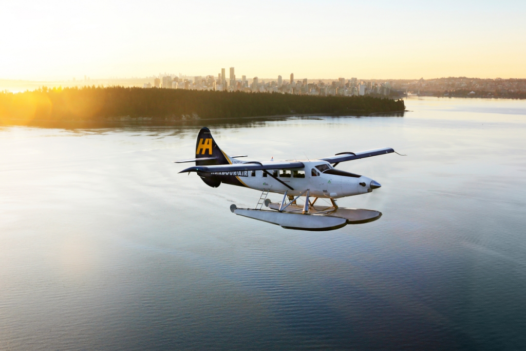 Harbour Air seaplane with Vancouver in the background | Harbour Air