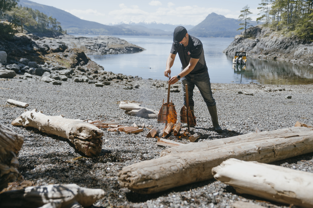 Cooking salmon on a beach in Port Hardy