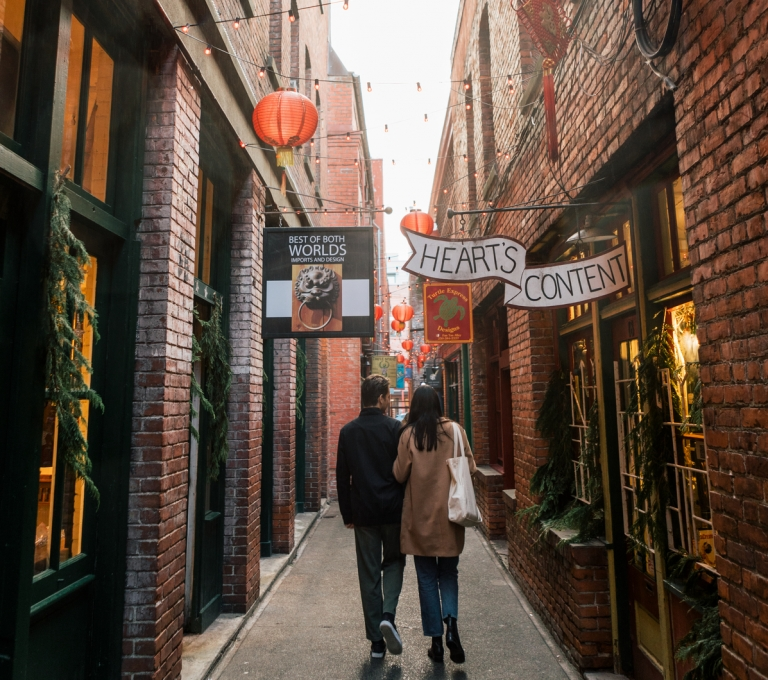 Couple wander through Fan Tan Alley in Victoria | Jordan Dyck