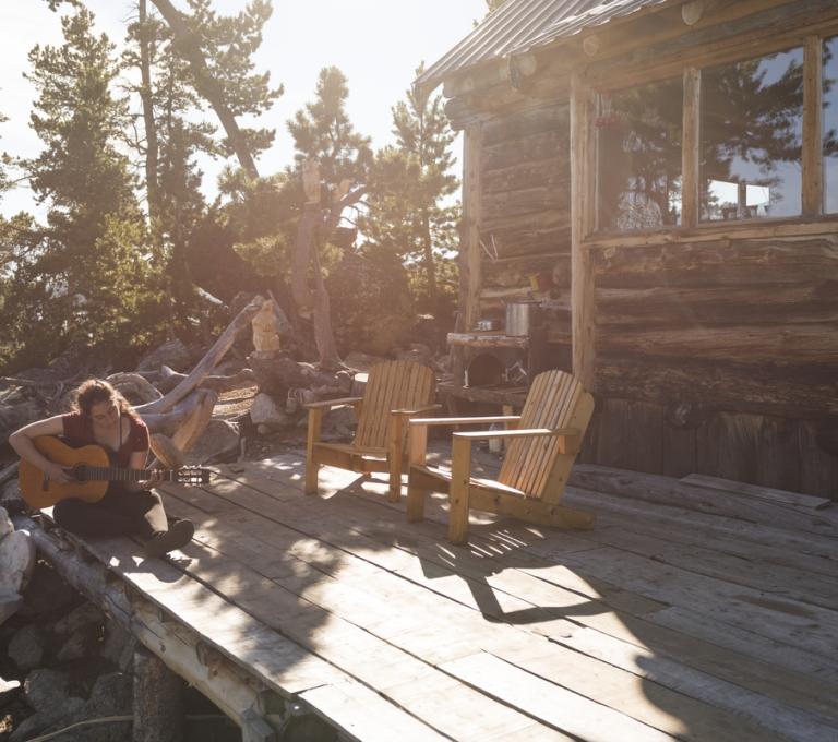 Guitarist and cabin at Nuk Tessli Wilderness Experience | Kari Medig