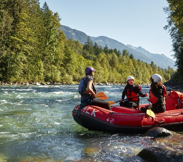 A group of friends river rafting on Vedder River | Hubert Kang