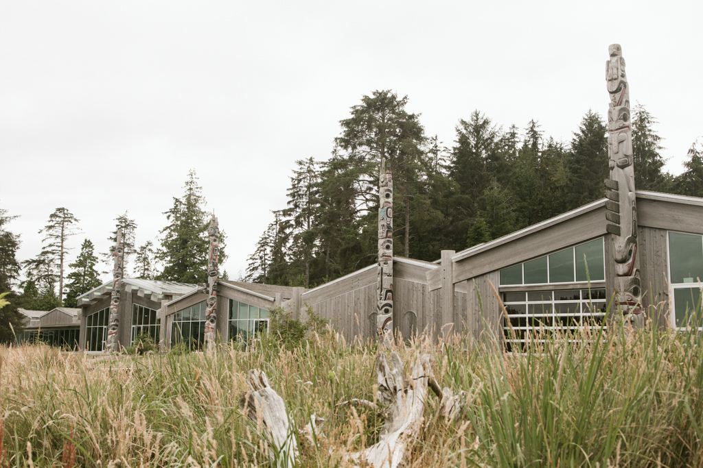 The Haida Heritage Centre is nestled amongst tall grass.