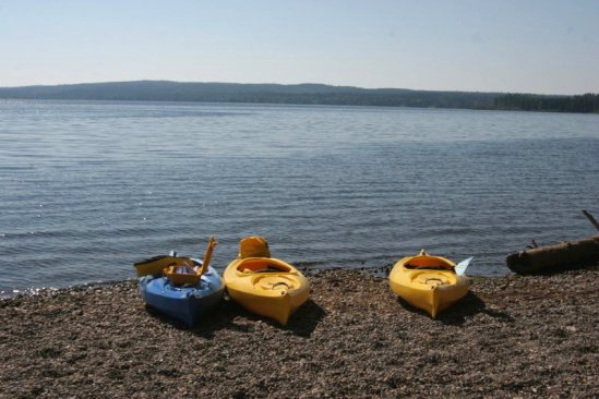 Kayaks on the shore of West Lake.