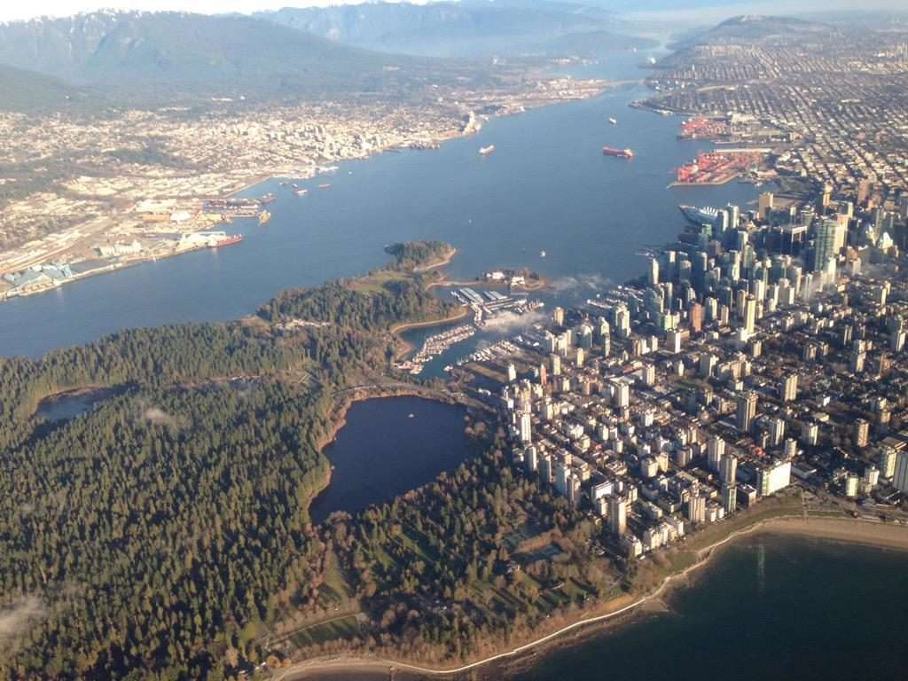 Aerial view of Stanley Park and Downtown Vancouver.