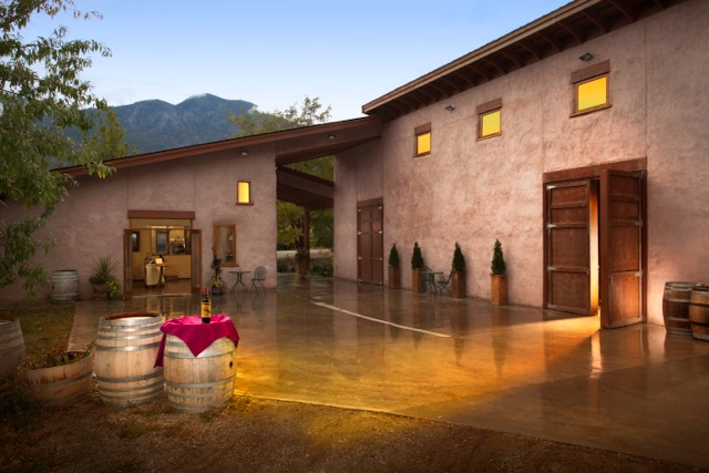 The exterior of a stunning winery at sunset.