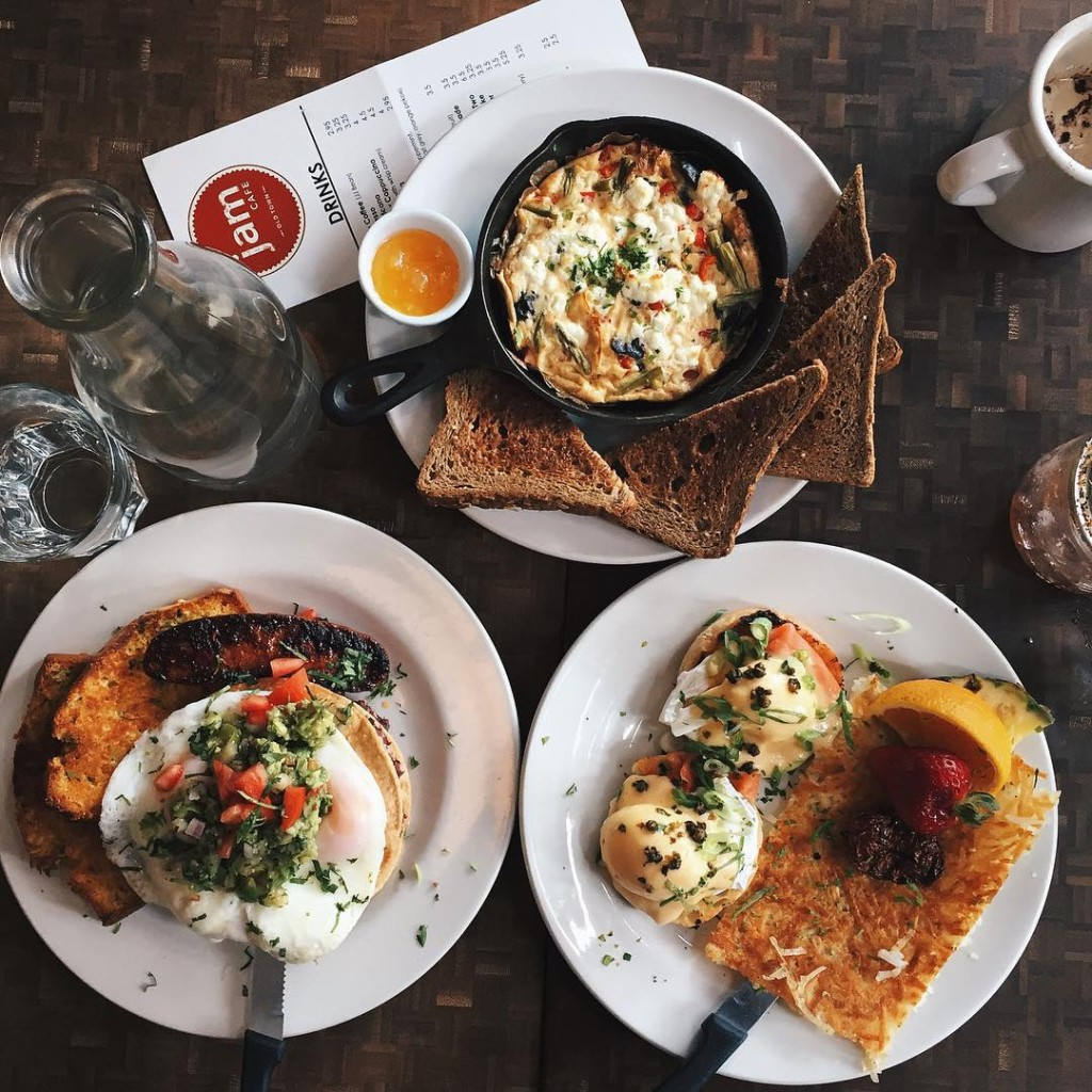 Three carefully plated breakfast dishes, including eggs benedict, a frittata, and huevos rancheros
