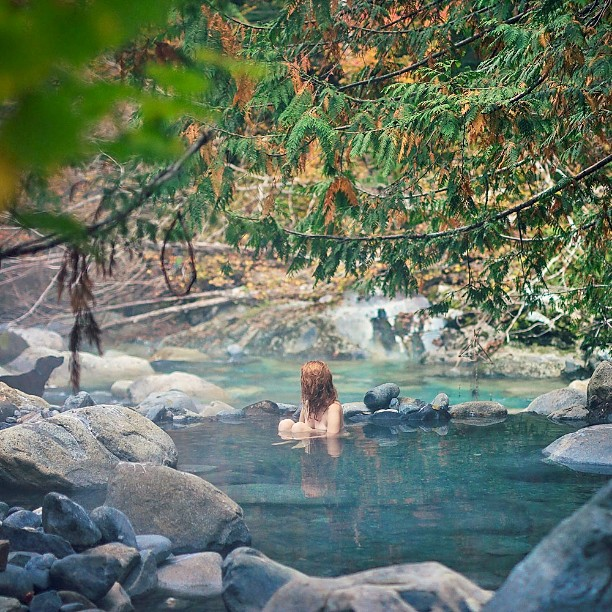 A woman enjoys some private time in a secluded hot spring.
