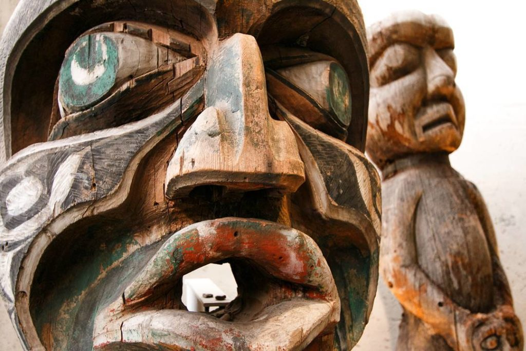 Weathered First Nations totems.
