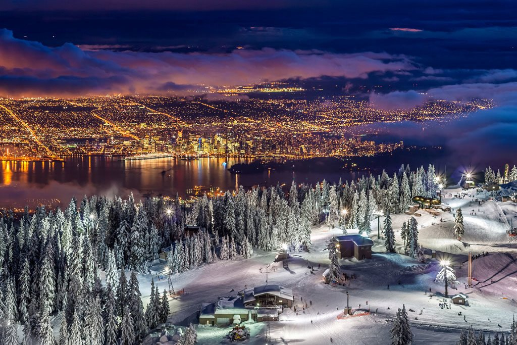Skiing over Vancouver's city lights on Grouse Mountain.