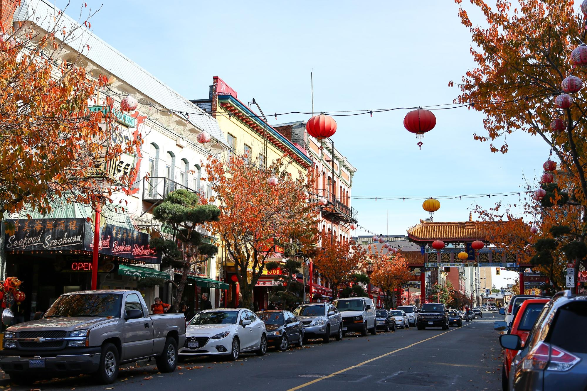 Colourful Chinese lantern strung across a city street.