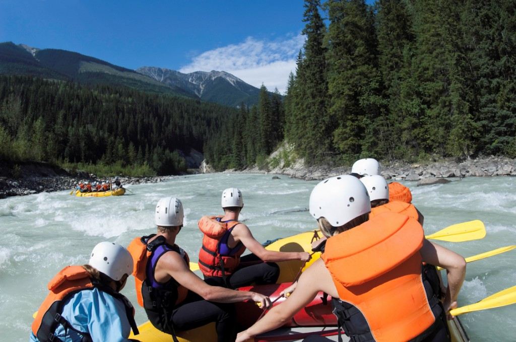Groups of adventurers enjoy some white water rafting.
