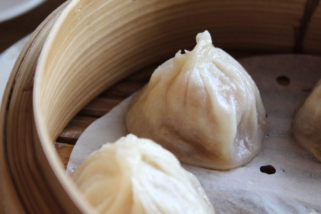 A dish of Xiao long bao dumplings.