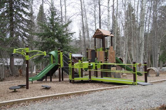 A bright neon green children's playground.