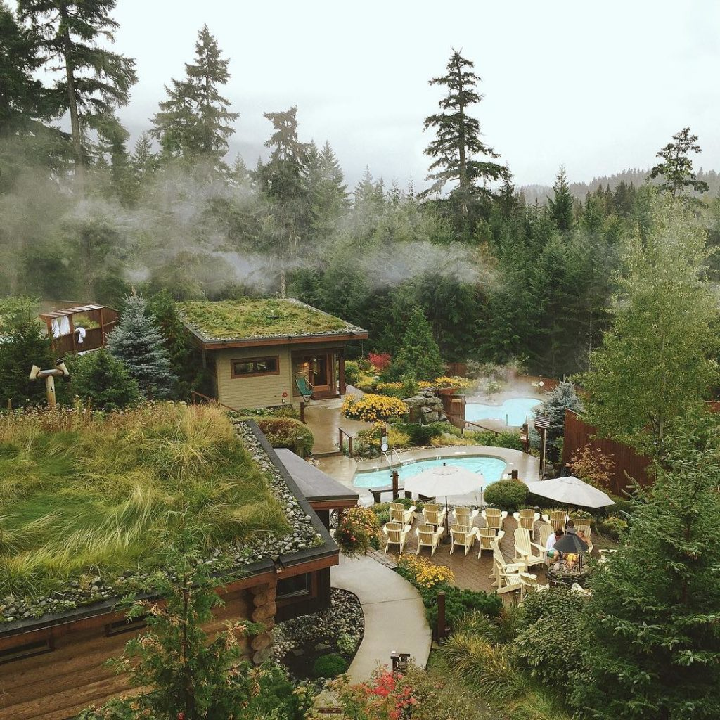 Outdoor mineral pools emit steam at Scandinave Spa, Whistler.