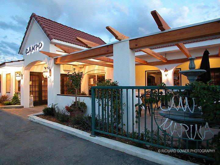 The white stone exterior of a restaurant called Capo Marina.