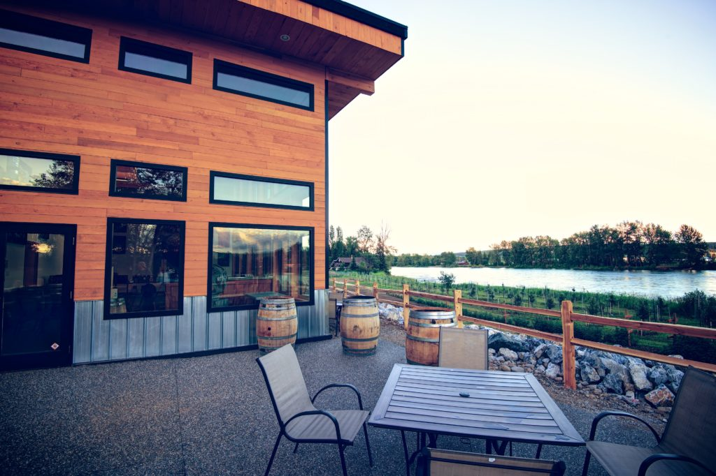 The patio at Northern Lights Estate Winery has a view of the water at sunset.