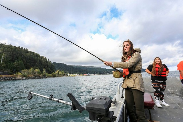 Kate Middleton, Duchess of Cambridge, fishing under a cloudy sky.