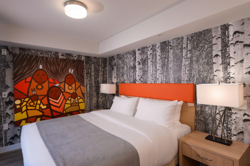 A luxurious suite in Vancouver's Skwachàys Lodge, complete with aboriginal artwork and a king size bed.