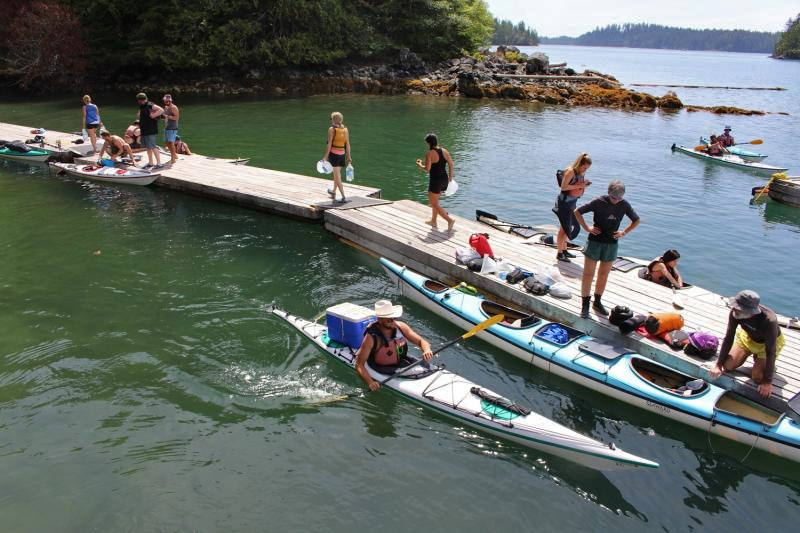 A long floating wharf acts as a debarking point for kayakers.