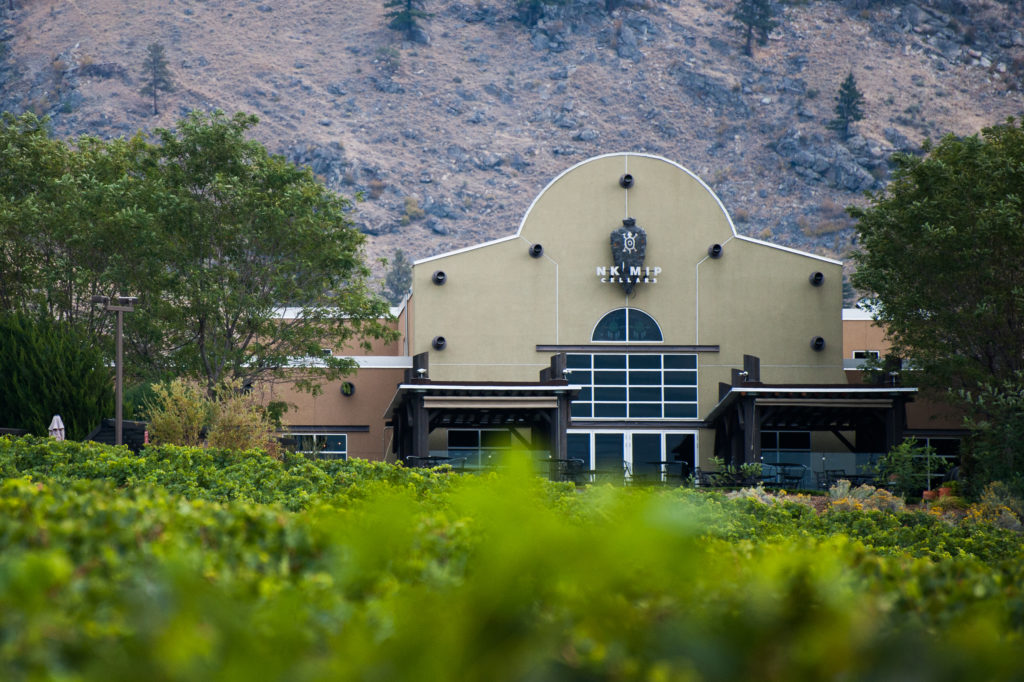 The entrance to Nk'Mip Cellars, nestled in a mountainous landscape.