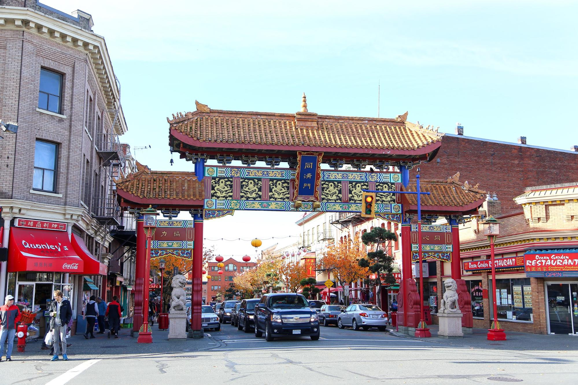 An intricately designed entrance on a city street to Chinatown.