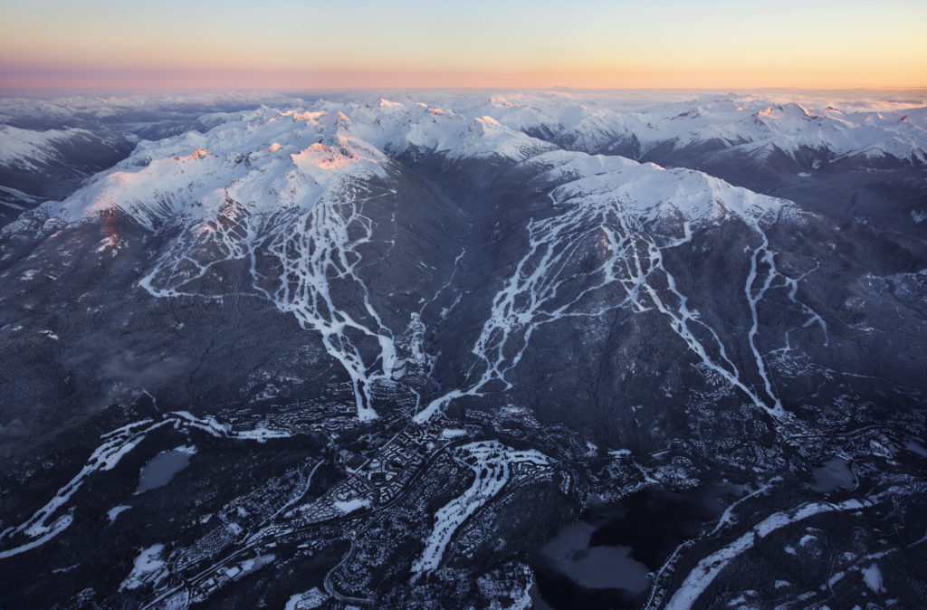 An aerial view of a snow capped mountain range.