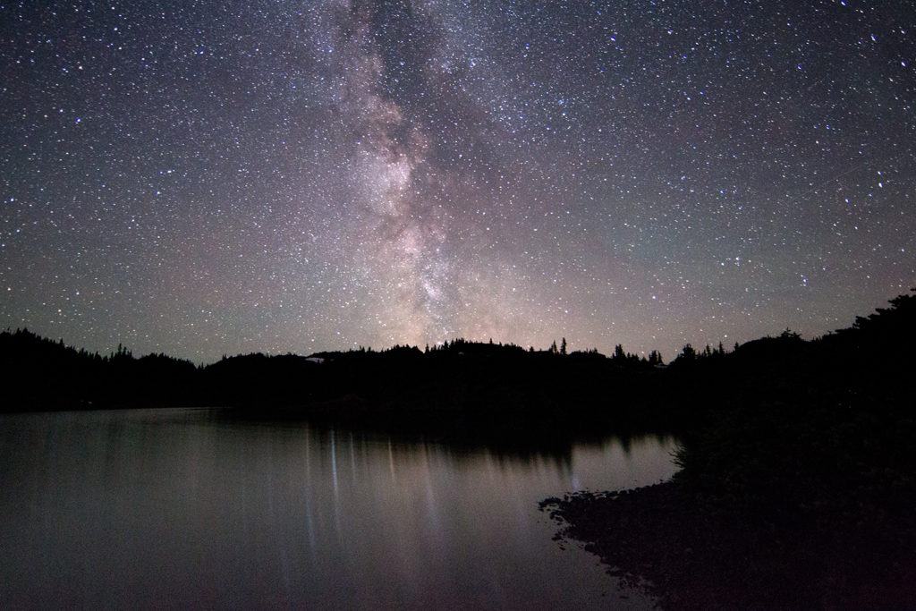 The Milky Way on a dark, moonless night reflected in a small sub-alpine lake near Terrace.