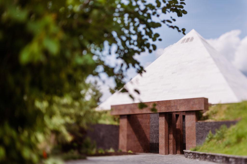 A pyramid-shaped winery under a blue sky.