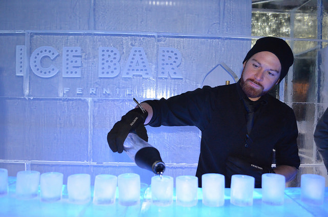 A bartender pours shots into ice shot glasses at the Fernie Ice Bar.