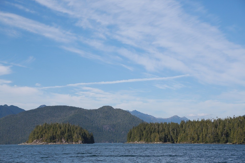 Two small islands with Vancouver Island in the background.