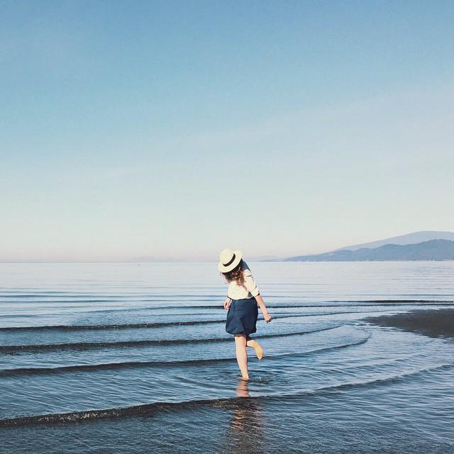 Wading in the waters at Wreck Beach in Vancouver. Photo: @racheycakes via Instagram