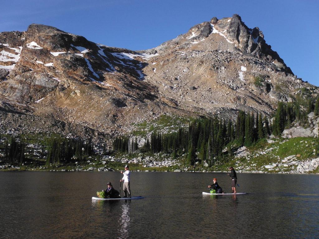Paddleboarding on alpine lakes near Ice Creek Lodge, outside Nelson.
