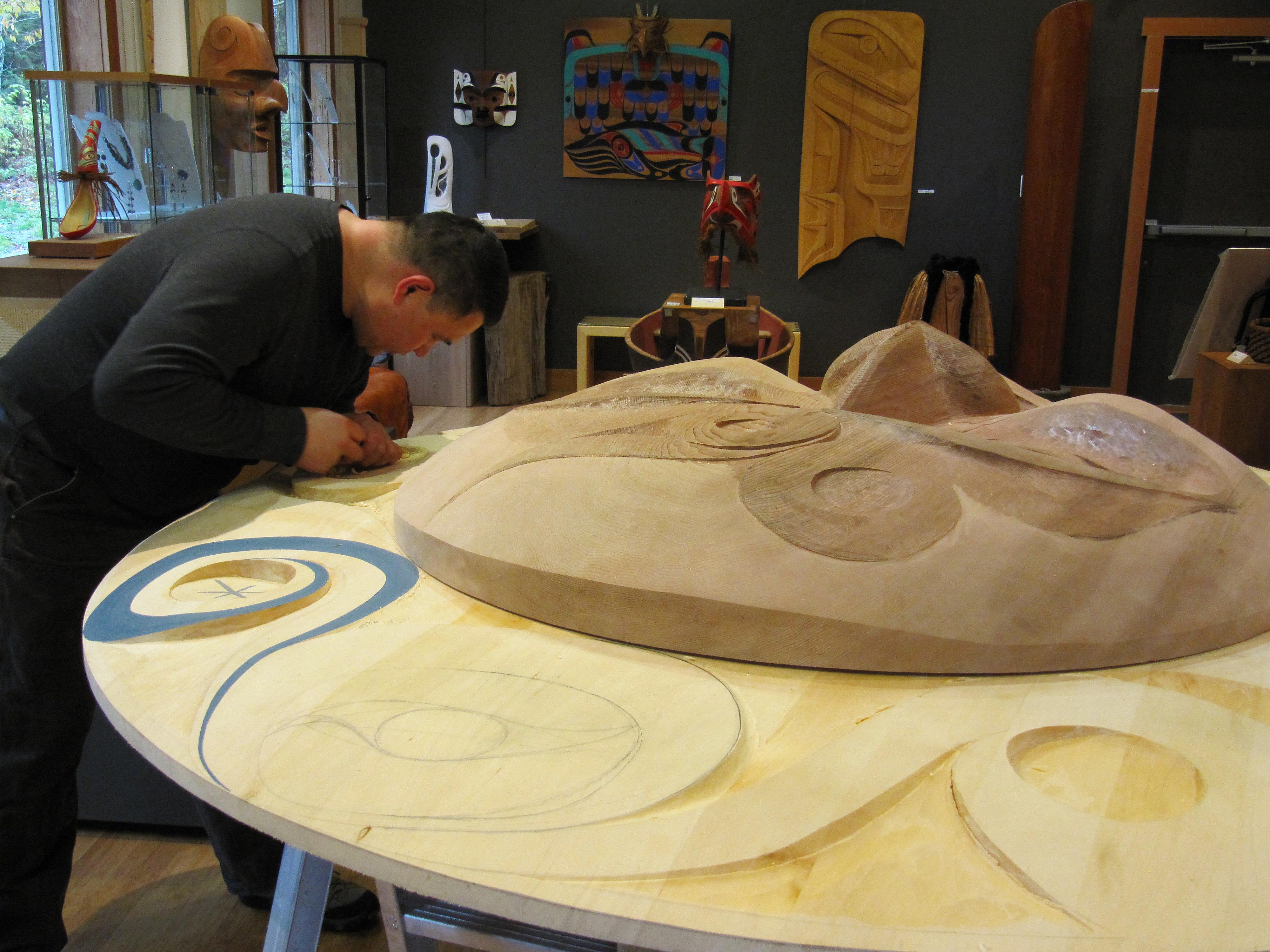 Gordon Dick carves aboriginal art work at Ahtsik Native Art Gallery in Port Alberni