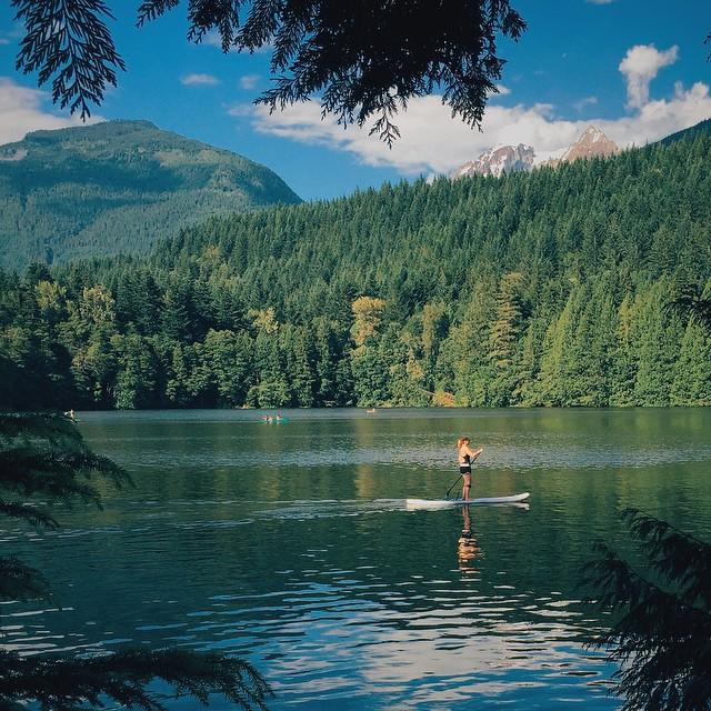 Stand-up paddle boarding at Alice Lake Provincial Park near Squamish