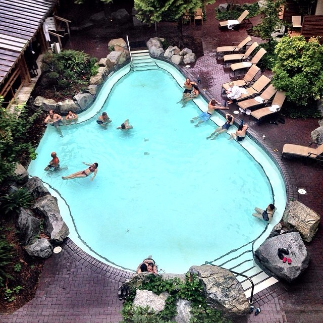 Vacationers lounging in the pool at Harrison Hot Springs Resort.