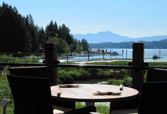 An al fresco meal on the patio of Drinkwater's Social House at Sproat Lake Landing on Vancouver Island.