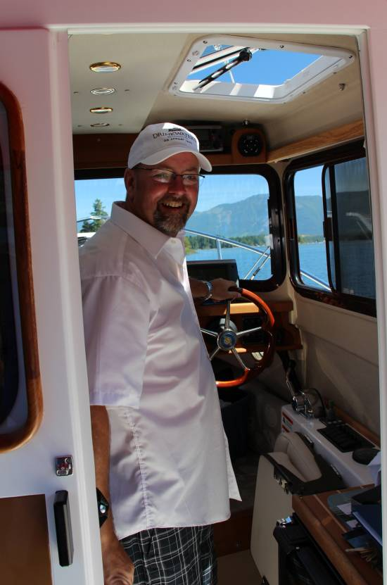 Captain Jeff Stephenson leading a tugboat tour of Sproat Lake on Vancouver Island.