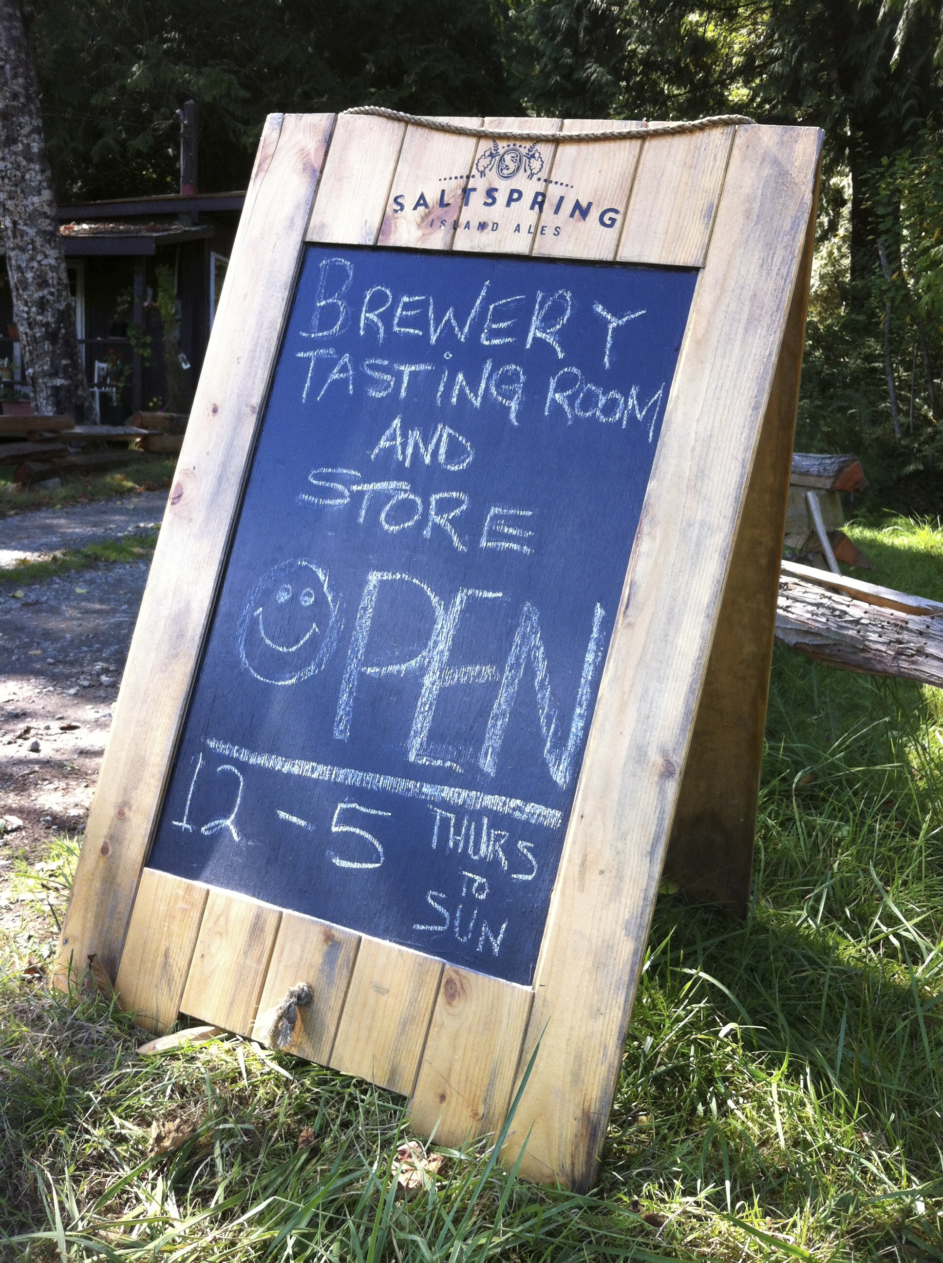 A sign advertising Salt Spring Island Ale' tasting room and store.