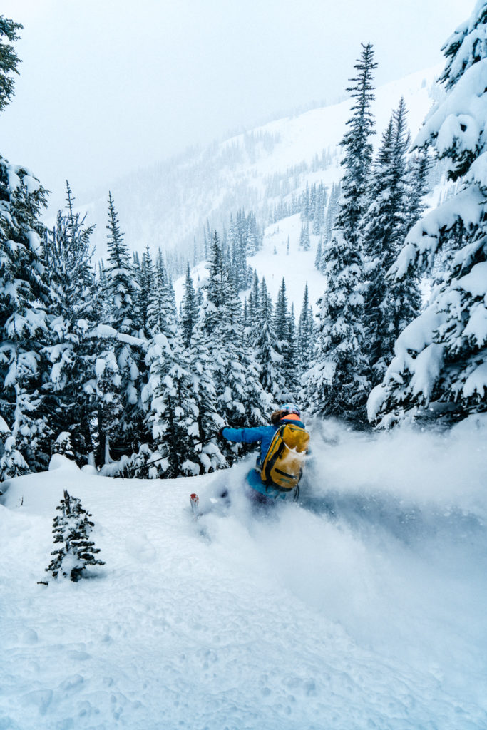 Skiing through powder on opening day, Whistler. Photo: @michaeloverbeck
